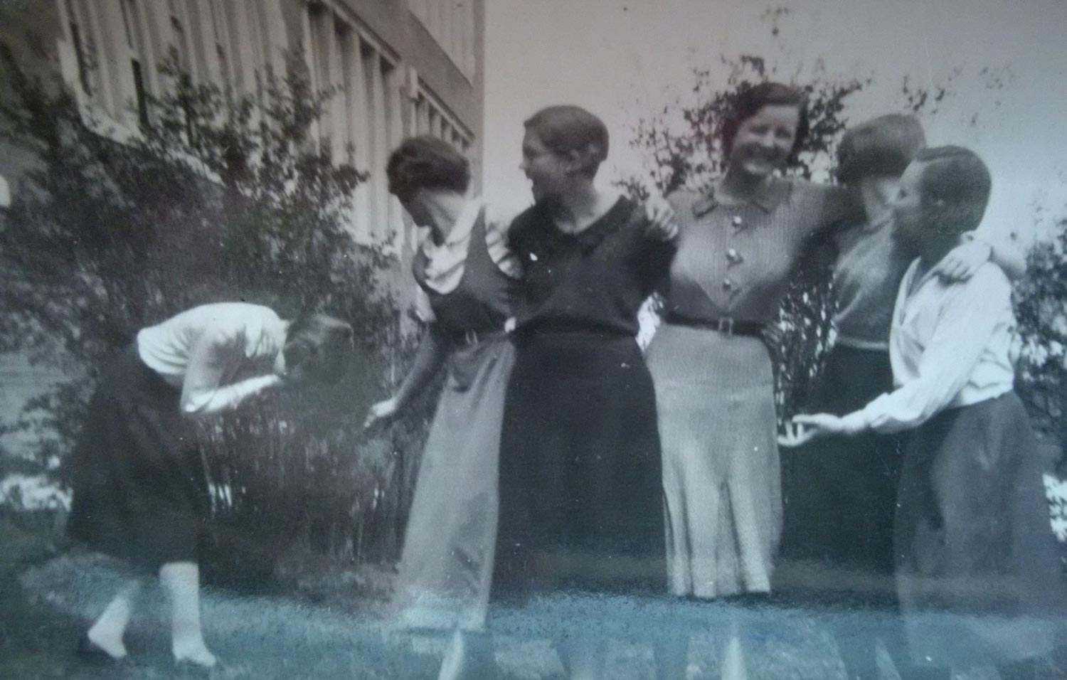 vintage photo of young women hugging and laughing